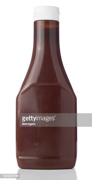blank bottle containing a brown liquid with a squirt top lid - barbeque sauce stock photos and pictures