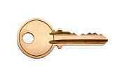 A blank brass key against a white background