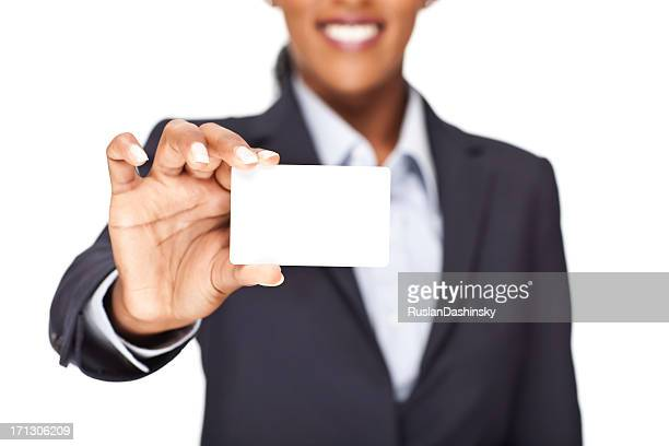 A blank business card being held up to view