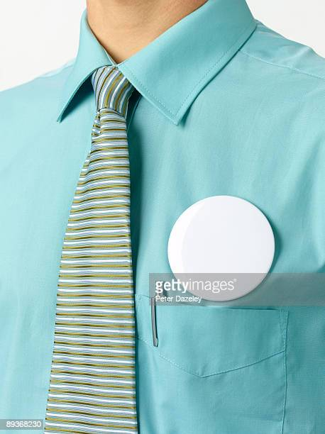 Blank button badge on blue collar worker.