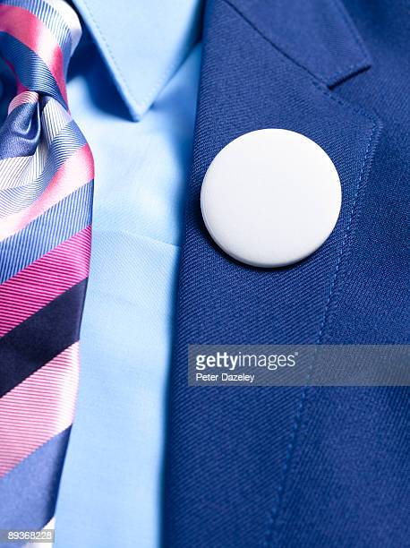 Blank button badge on lapel.