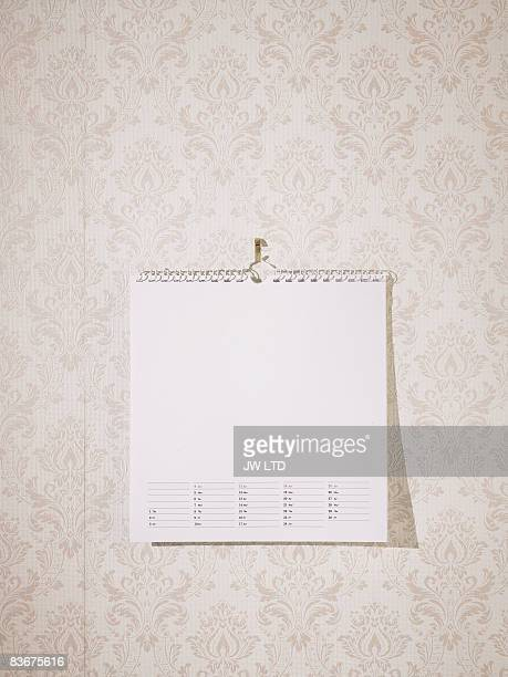 Blank calendar against wallpaper