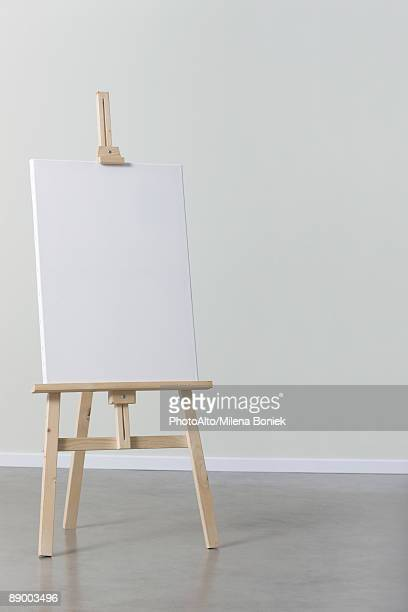 blank canvas on easel - easel stock pictures, royalty-free photos & images