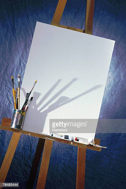 Blank canvas with paint supplies