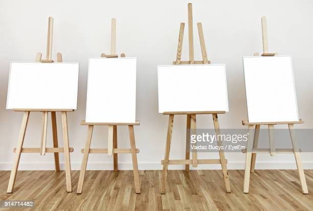 Blank Canvases On Easels By White Wall