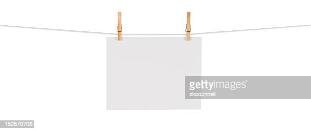 Blank Card Hanging on a Clothesline against White