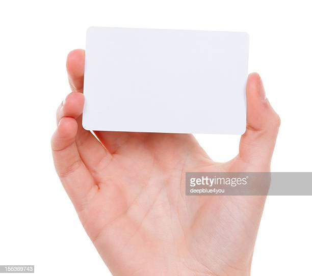 Blank card in female hand on white