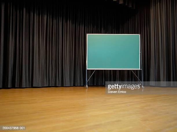 Blank chalkboard on school stage