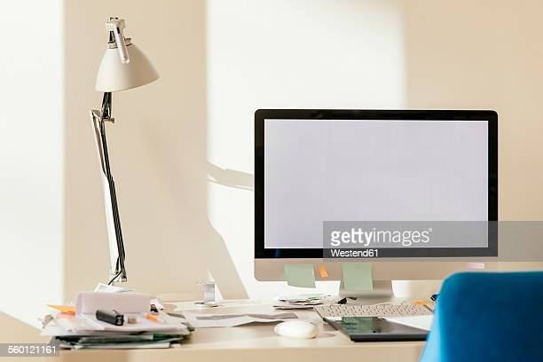 Blank computer monitor on desk