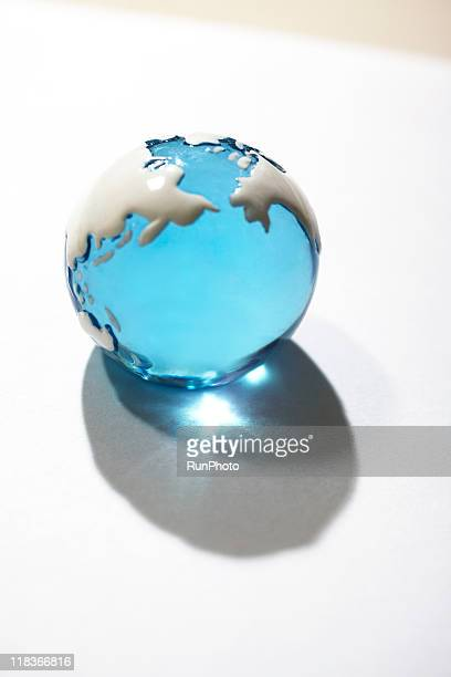 blank concept,earth-shaped clear ball on the table