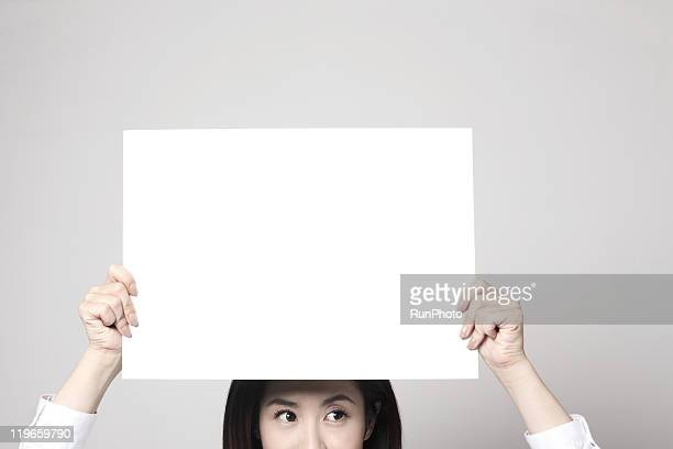 blank concept,young woman holding whiteboard