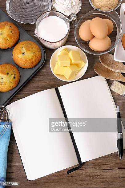 Blank cookbook with muffins and ingredients