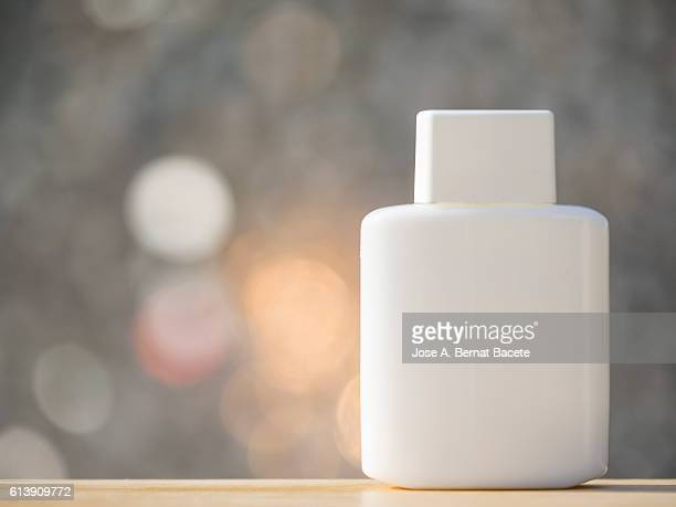 Blank cosmetics containers, close up,  illuminated by sunlight