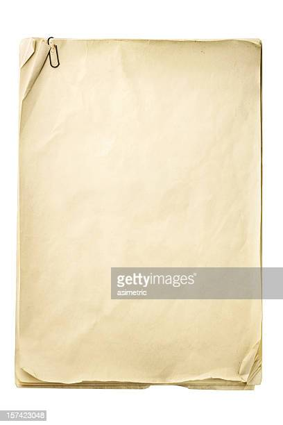 blank crinkly beige paper with paper clip - paper clips stock photos and pictures
