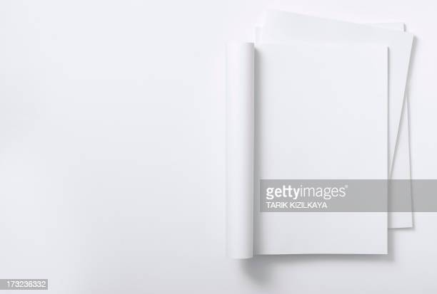 blank curved magazine on a magazine stack - magazine page stock photos and pictures