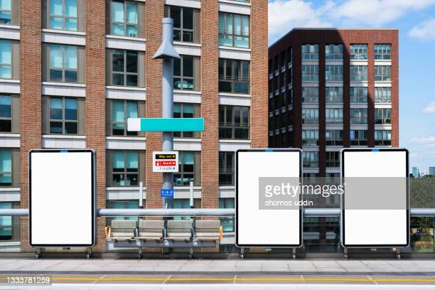 blank digital screens at platform in train station - railway station stock pictures, royalty-free photos & images