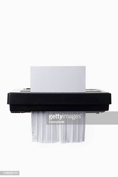 A blank document in a paper shredder