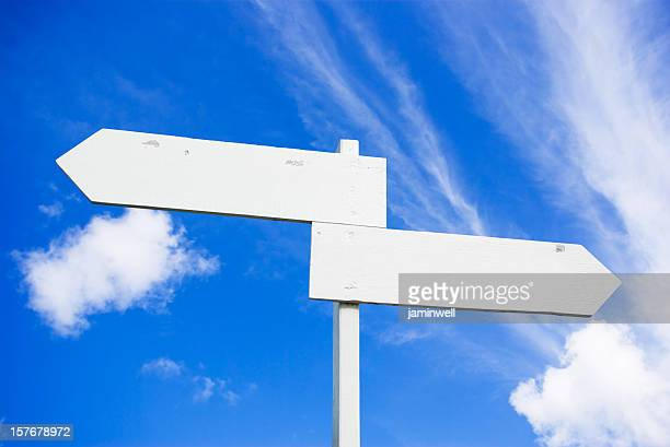 blank double arrow directional sign and blue sky