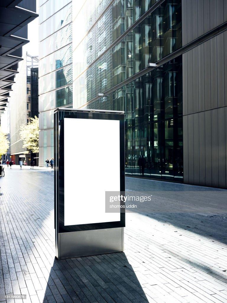 Blank electronic billboard on busy street in London : Stock Photo