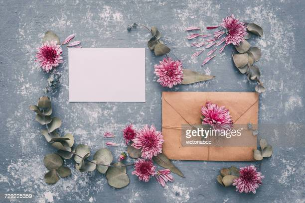 Blank envelope and card with flowers