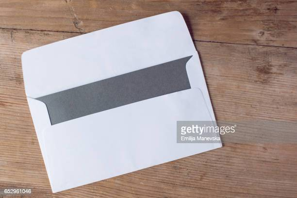 Blank envelope and gray paper