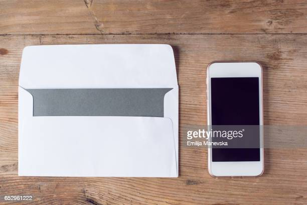 Blank envelope and mobile phone