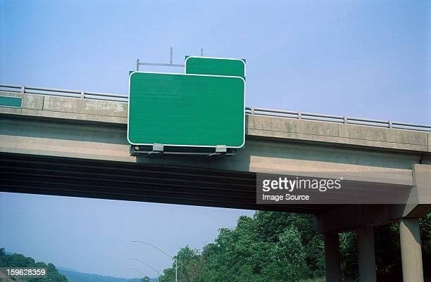 blank exit sign on highway overpass - road sign stock pictures, royalty-free photos & images