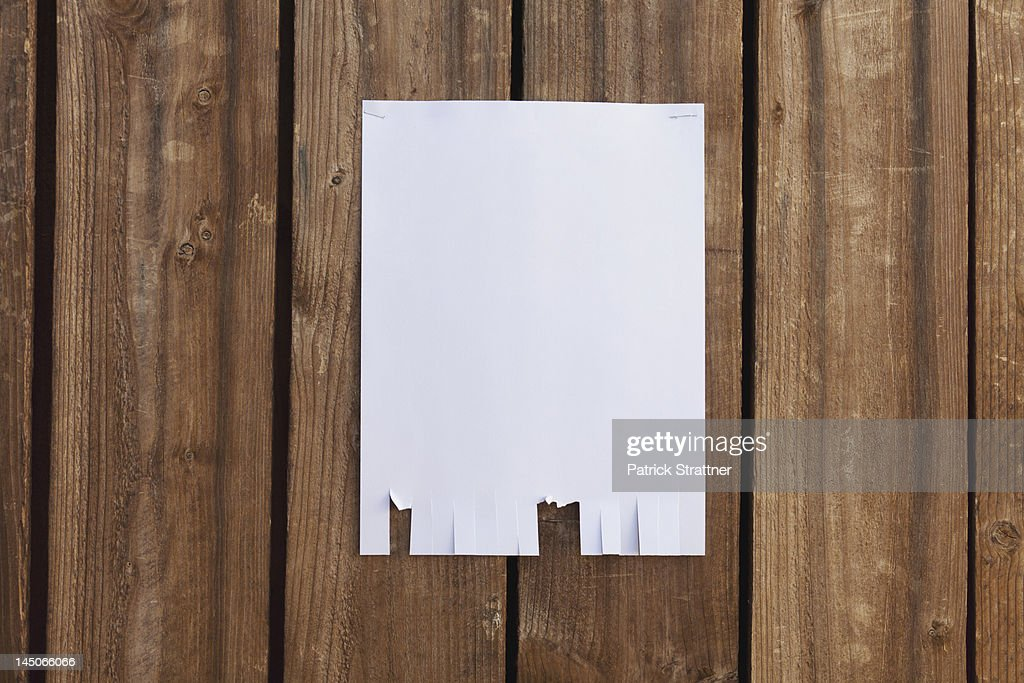 A blank flyer hanging on a wooden fence : Stock Photo