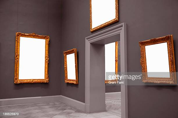 Blank framed paintings in museum.