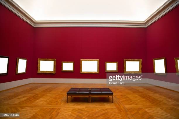 blank frames hanging on art gallery wall. - galleria d'arte foto e immagini stock