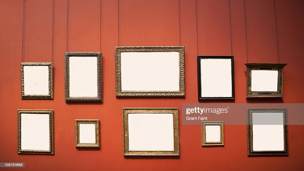 10 blank frames on wall : Stock Photo