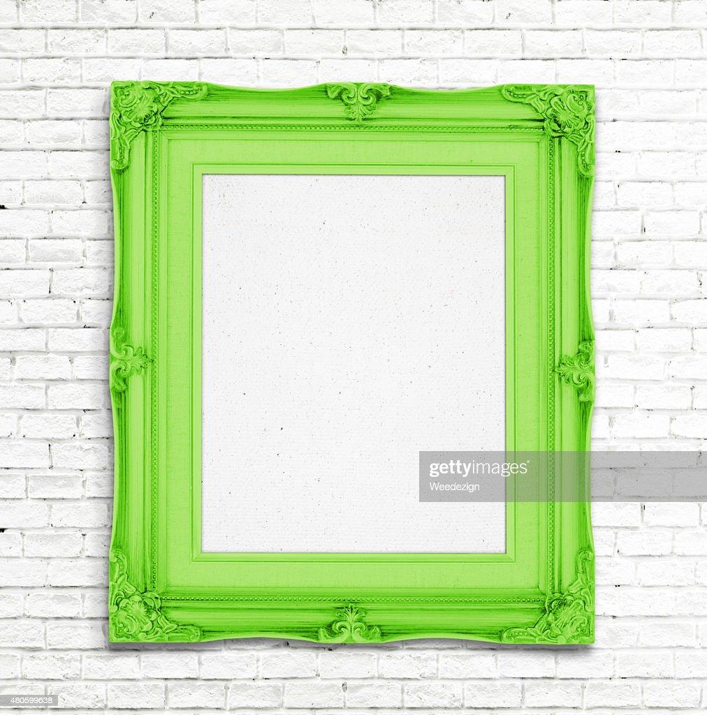 Blank green Vintage photo frame on white brick wall : Stock Photo