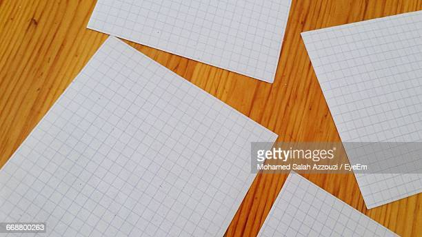 Blank Grid Paper Sheets On Table