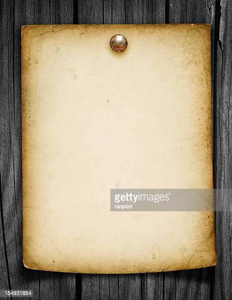 Blank Grungy Paper Tacked to a Wood Post