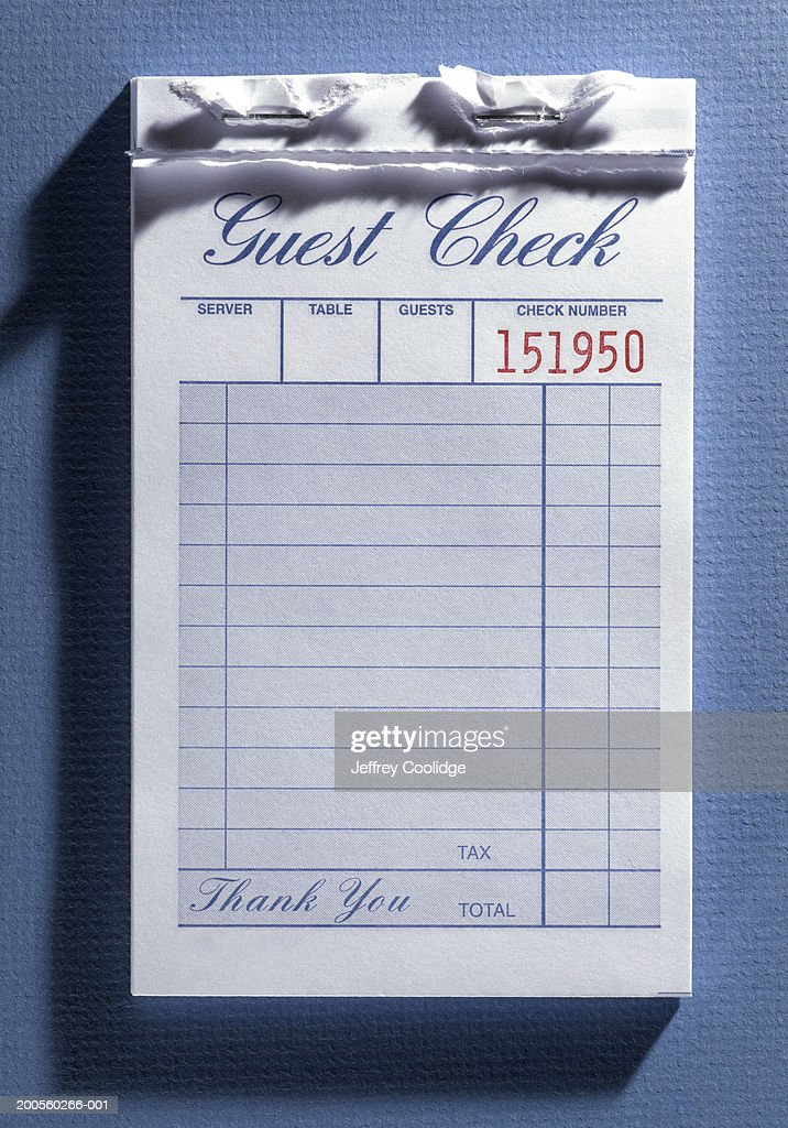 blank guest check from restaurant in receipt book overhead view