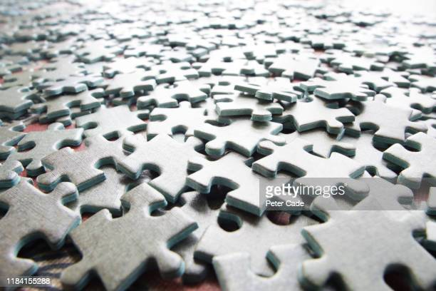 blank jigsaw pieces - differential focus stock pictures, royalty-free photos & images