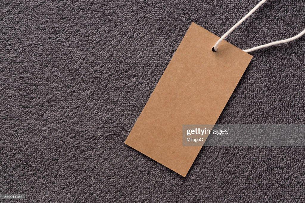 Blank Kraft Label on Towel Background : Stock Photo
