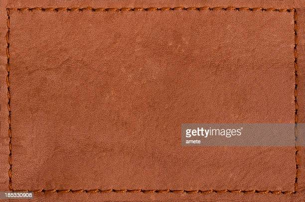 blank leather jeans label isolated on white background - spijkerbroek stockfoto's en -beelden