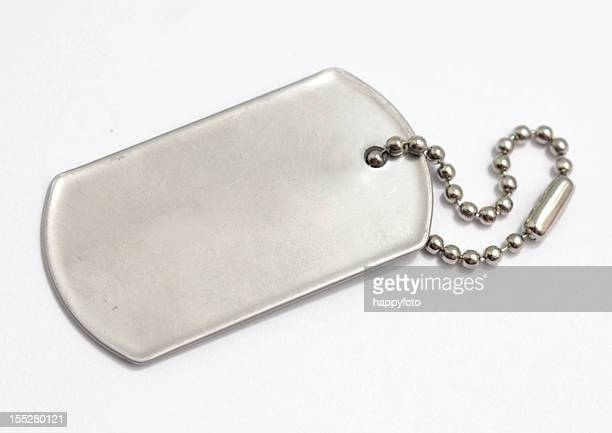 blank, metal dog tag on white background - medallion stock photos and pictures
