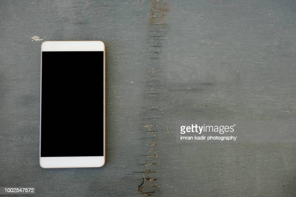 Blank mock up mobile with copy space on table