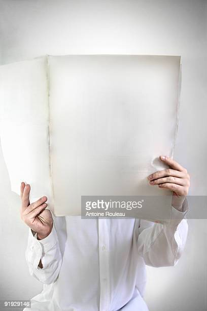 Blank newspaper and reader