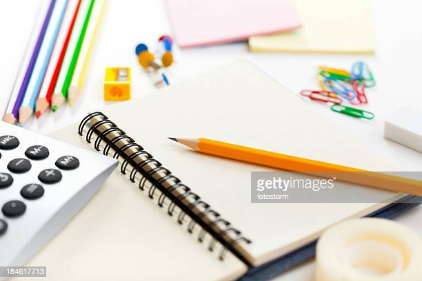 Blank notebook and office or school supplies
