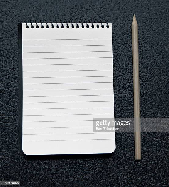 A blank notebook with pencil