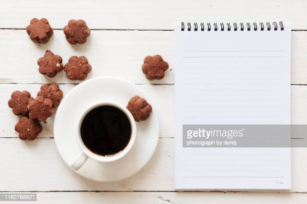 blank notebook-coffee-cookies-wooden pallet - coffee break stock pictures, royalty-free photos & images