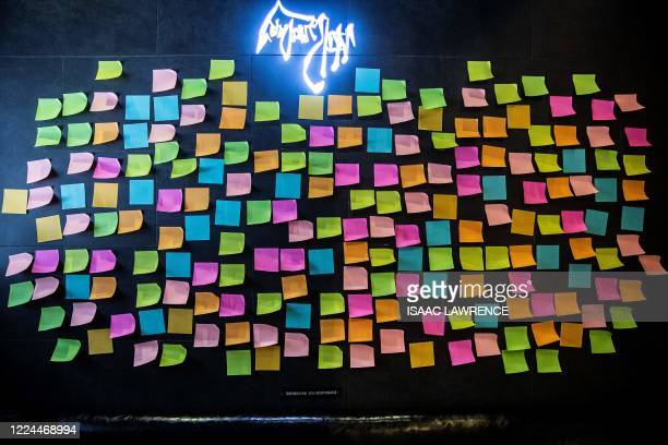 Blank notes are seen on a Lennon Wall inside a pro-democracy restaurant in Hong Kong on July 3 in response to a new national security law introduced...