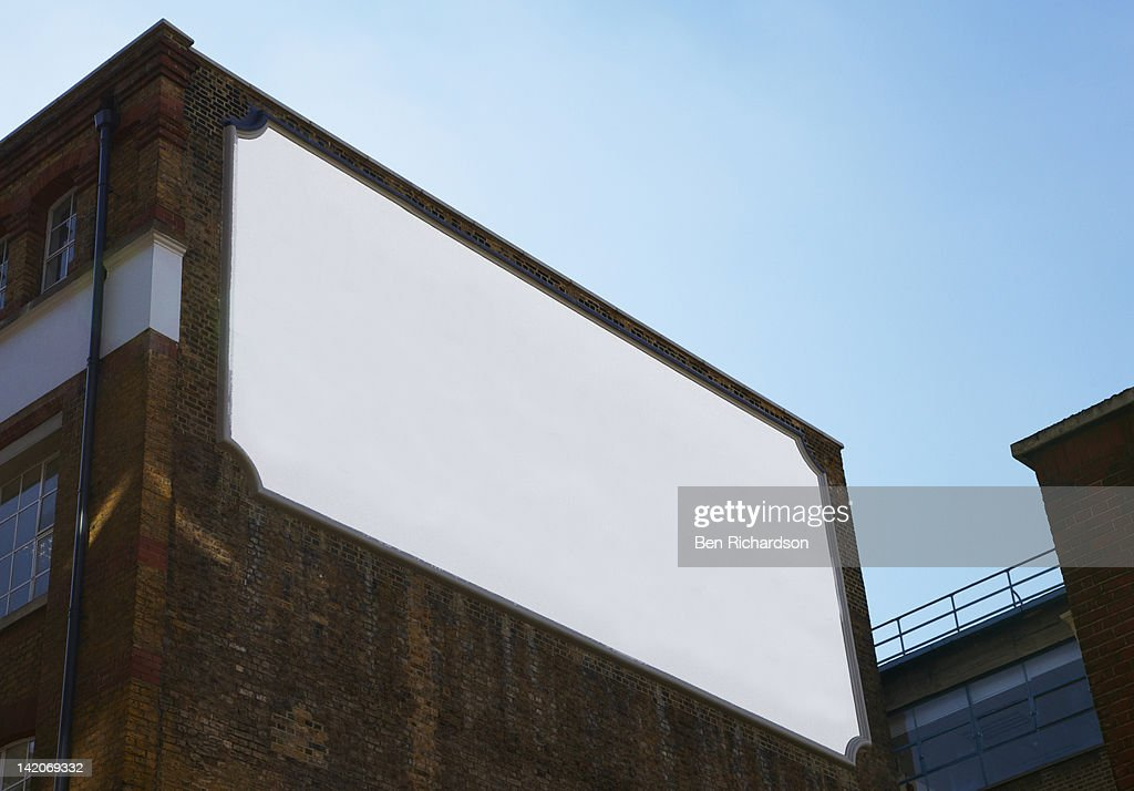 A blank old fashioned bill board on the side of a : Stock Photo
