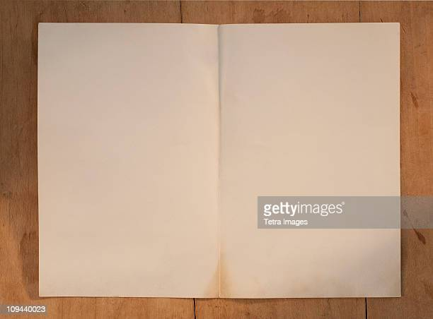 Blank page on wooden table
