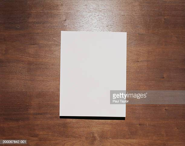 Blank paper on wood background
