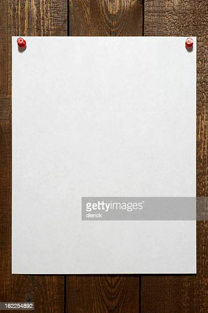 Blank Paper Pinned to Wall