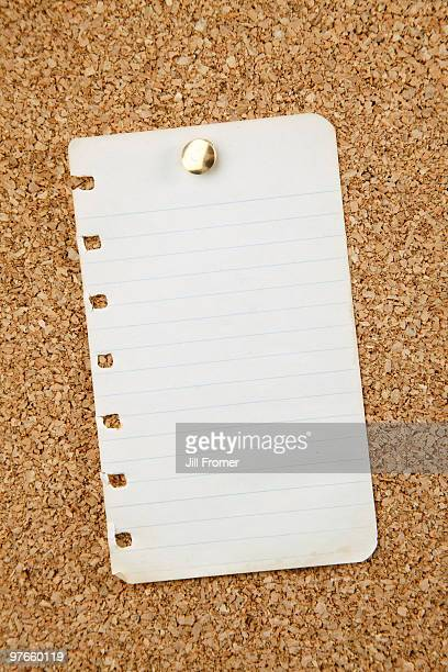 blank paper scrap pinned to corkboard - scrap metal stock photos and pictures
